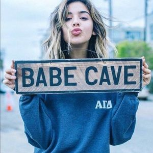 Brandy Melville wooden babe cave sign